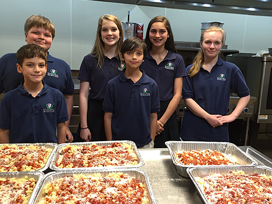 Episcopal Collegiate School students with pasta trays